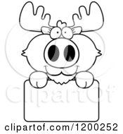 Cartoon Of A Black And White Cute Moose Calf Over A Sign Royalty Free Vector Clipart