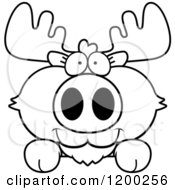 Cartoon Of A Black And White Cute Moose Calf Over A Surface Or Sign Royalty Free Vector Clipart