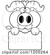 Cartoon Of A Black And White Cute Ox Calf Over A Sign Royalty Free Vector Clipart