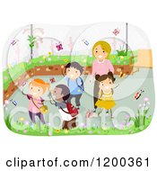 Cartoon Of A Female Teacher And Happy Diverse School Children In A Butterfly Garden Royalty Free Vector Clipart