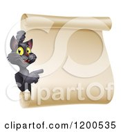 Cartoon Of A Black Halloween Cat Pointing To A Scroll Sign Royalty Free Vector Clipart