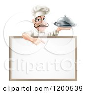 Cartoon Of A Male Chef Holding A Platter And Pointing Down At A White Board Royalty Free Vector Clipart