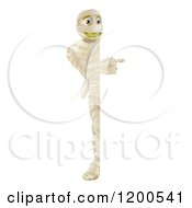 Cartoon Of A Happy Halloween Mummy Looking Around And Pointing At A Sign Royalty Free Vector Clipart