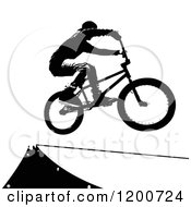 Clipart Of A Black Silhouetted Sports Bike Rider Over A Ramp Royalty Free Vector Illustration