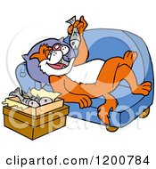 Fat Ginger Cat Relaxing On A Sofa And Eating Fish