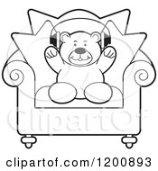 Cartoon Of A Black And White Teddy Bear Wearing Headphones On A Chair Royalty Free Vector Clipart by Lal Perera