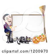 Cartoon Of A Grinning Vampire Pointing To A Halloween Sign With A Black Cat Broomstick And Pumpkins Royalty Free Vector Clipart by AtStockIllustration