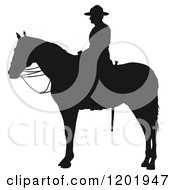 Clipart Of A Black And White Silhouetted Man Mounted On Horseback Royalty Free Vector Illustration
