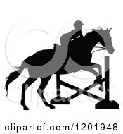 Clipart Of A Black And White Silhouetted Horseback Girl Leaping A Post Royalty Free Vector Illustration by Maria Bell