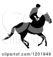 Clipart Of A Black And White Silhouetted Horseback Jockey Royalty Free Vector Illustration
