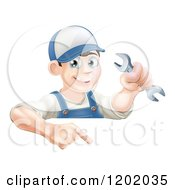 Poster, Art Print Of Happy Brunette Worker Man Holding A Wrench And Pointing Down At A Sign