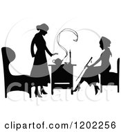 Clipart Of Vintage Black And White Silhouetted Ladies Talking Over Tea Royalty Free Vector Illustration