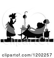 Clipart Of A Vintage Black And White Silhouetted Lady And Maid Royalty Free Vector Illustration