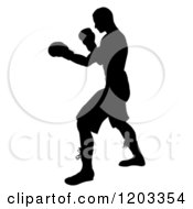 Clipart Of A Silhouetted Man Fighting With Boxing Gloves Royalty Free Vector Illustration by AtStockIllustration