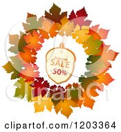 Clipart Of An Autumn Acorn Sales Tag In A Maple Leaf Wreath Royalty Free Vector Illustration by elaineitalia