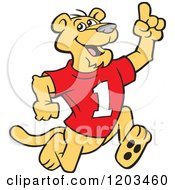 Cartoon Of A Victorious Cougar Mascot Wearing A 1 Jersey And Holding Up A Number One Finger Royalty Free Vector Clipart