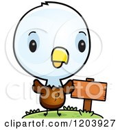 Cartoon Of A Cute Baby Bald Eagle By A Sign Post Royalty Free Vector Clipart