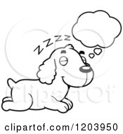Cartoon Of A Black And White Cute Spaniel Puppy Dreaming Royalty Free Vector Clipart by Cory Thoman