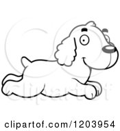 Cartoon Of A Black And White Cute Spaniel Puppy Running Royalty Free Vector Clipart by Cory Thoman