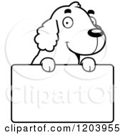 Cartoon Of A Black And White Cute Spaniel Puppy Over A Sign Royalty Free Vector Clipart by Cory Thoman