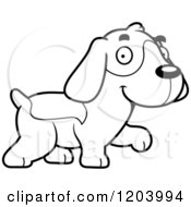 Cartoon Of A Black And White Cute Beagle Puppy Walking Royalty Free Vector Clipart by Cory Thoman