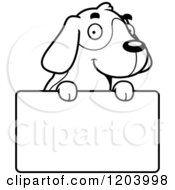 Cartoon Of A Black And White Cute Beagle Puppy Over A Sign Royalty Free Vector Clipart by Cory Thoman