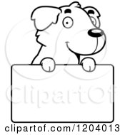 Cartoon Of A Black And White Cute Golden Retriever Puppy Over A Sign Royalty Free Vector Clipart