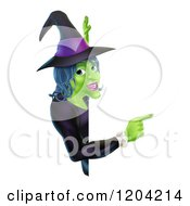Cartoon Of A Green Halloween Witch Pointing To A Sign Royalty Free Vector Clipart