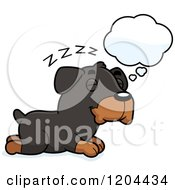Cartoon Of A Cute Rottweiler Puppy Dog Dreaming Royalty Free Vector Clipart