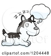 Cartoon Of A Cute Husky Puppy Dog Dreaming Royalty Free Vector Clipart