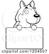 Cartoon Of A Black And White Cute Husky Puppy Dog Over A Sign Royalty Free Vector Clipart by Cory Thoman