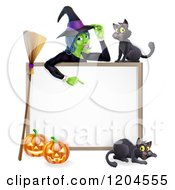 Cartoon Of A Witch Pointing Down To A White Board Sign With Black Cats Halloween Pumpkins And A Broomstick Royalty Free Vector Clipart