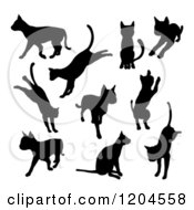 Clipart Of Black Silhouetted Cats Sitting Jumping Playing And Walking Royalty Free Vector Illustration