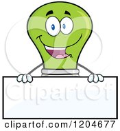 Cartoon Of A Happy Green Light Bulb Mascot Over A Sign Royalty Free Vector Clipart