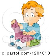 Cartoon Of A Happy Red Haired White Boy Holding A Shirt Royalty Free Vector Clipart