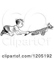 Clipart Of A Vintage Black And White Boy Pulling A Cats Tail Royalty Free Vector Illustration