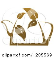 Tea Pot Of Brown Tea Or Coffee With Leaves