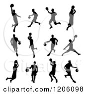 Clipart Of Black Silhouetted Basketball Players Royalty Free Vector Illustration by AtStockIllustration