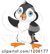 Cartoon Of A Cute Baby Penguin Pointing Royalty Free Vector Clipart #1206177 by Pushkin