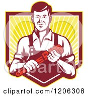 Retro Plumber Worker Man Holding A Monkey Wrench Over A Ray Crest Shield