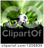 Clipart Of A Soccer Ball And Green Burst With Sports Fans Royalty Free Vector Illustration