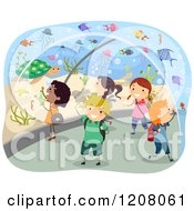 Cartoon Of A Group Of Diverse School Children Exploring An Aquarium Tunnel Royalty Free Vector Clipart