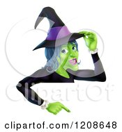 Cartoon Of A Green Halloween Witch Touching Her Hat And Pointing Down To A Sign Royalty Free Vector Clipart