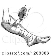 Clipart Of A Vintage Black And White Person Bandaging A Foot Royalty Free Vector Illustration
