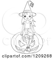 Black And White Witch Girl Sitting On A Halloween Jackolantern Pumpkin