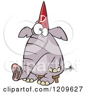 Cartoon Of A Dumb Elephant Sitting On A Stool And Wearing A Dunce Hat Royalty Free Vector Clipart