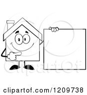 Cartoon Of A Black And White Happy Home Mascot Pointing To A Sign Royalty Free Vector Clipart