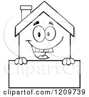 Cartoon Of A Black And White Happy Home Mascot Over A Sign Royalty Free Vector Clipart