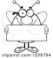 Cartoon Of A Black And White Happy Bee Mascot Holding A Sign Royalty Free Vector Clipart