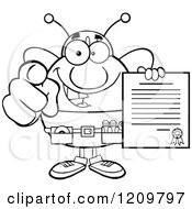 Cartoon Of A Black And White Happy Worker Bee Mascot Holding A Contract And Pointing Outwards Royalty Free Vector Clipart